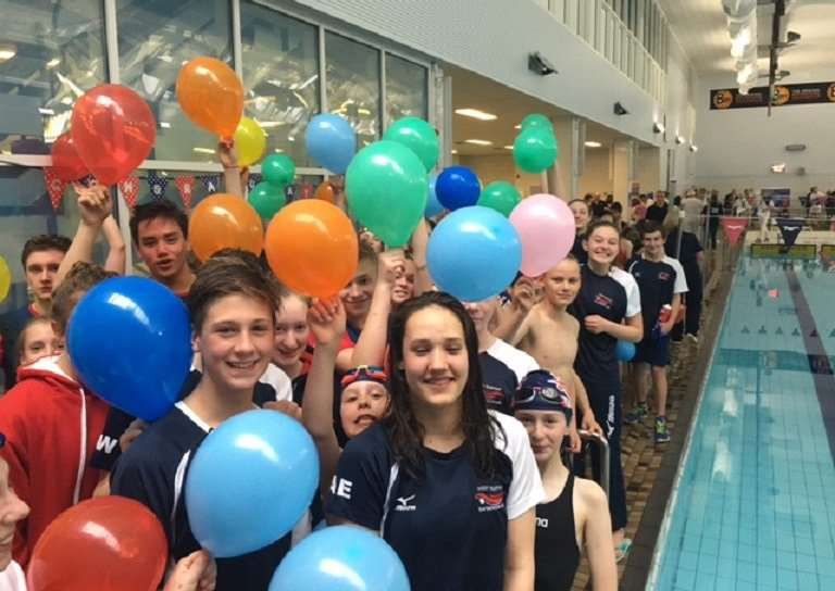 WELL-SUPPORTED: Angharad Evans being celebrated by her fellow swimmers after winning the British Championships