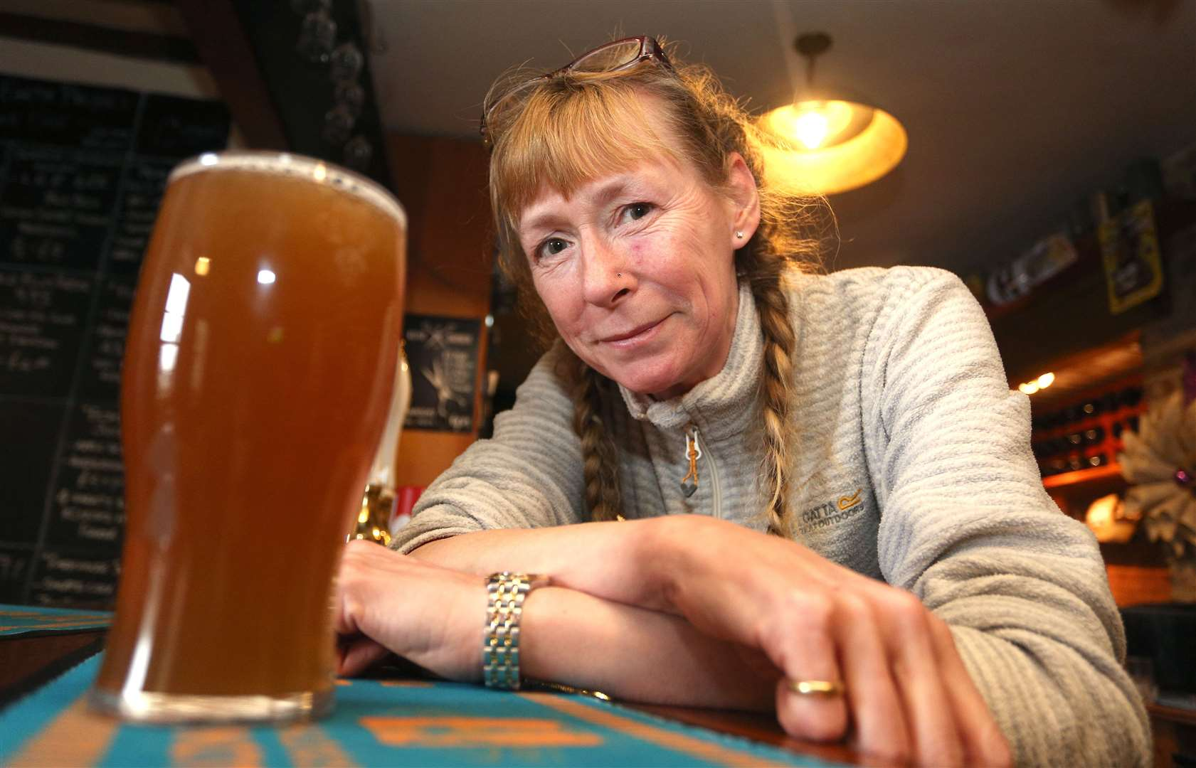 Landlady, Jane Binyon pours a pint for a customer at the White Horse Winter Beer Festival in Edwardstone..Pic - Richard Marsham. (29208568)