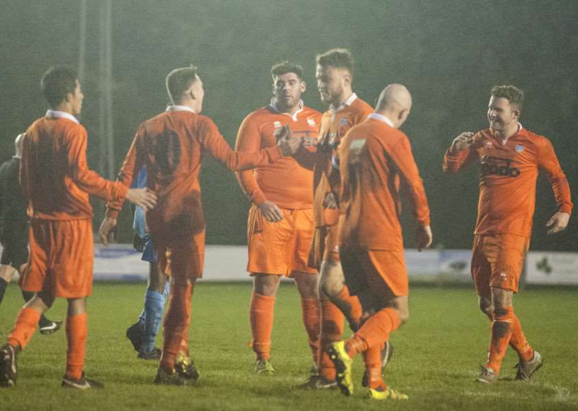CELEBRATION TIME: Diss Town players celebrate scoring during their emphatic 9-2 win over Braintree Town