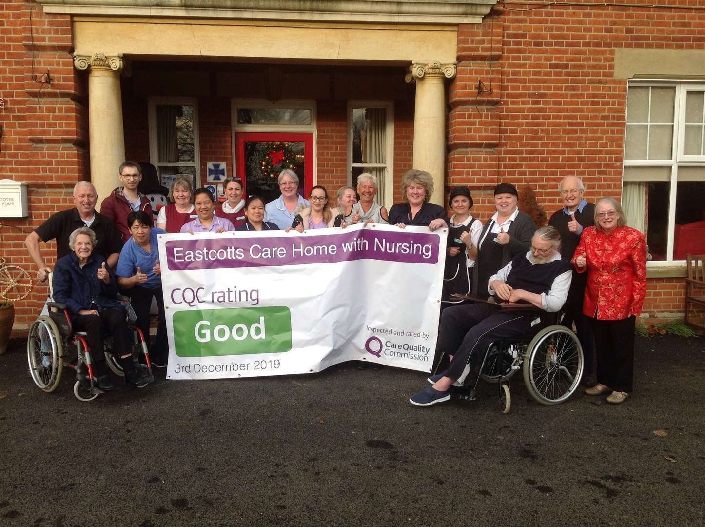 Staff and residents at Eastcotts Care Home with Nursing celebrate its improved CQC inspection. Contributed picture