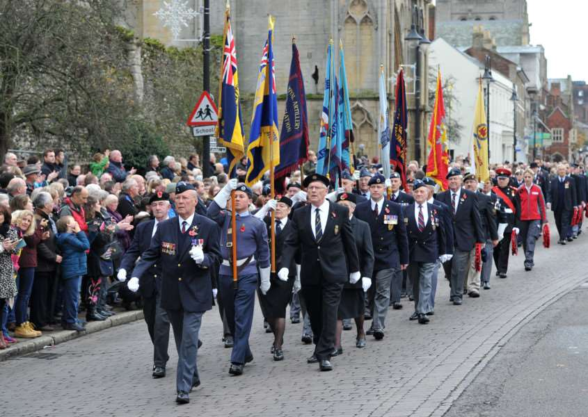 Standard bearers and members of ex-service organisations in the Remembrance Parade on Angel Hill ANL-150811-225355009