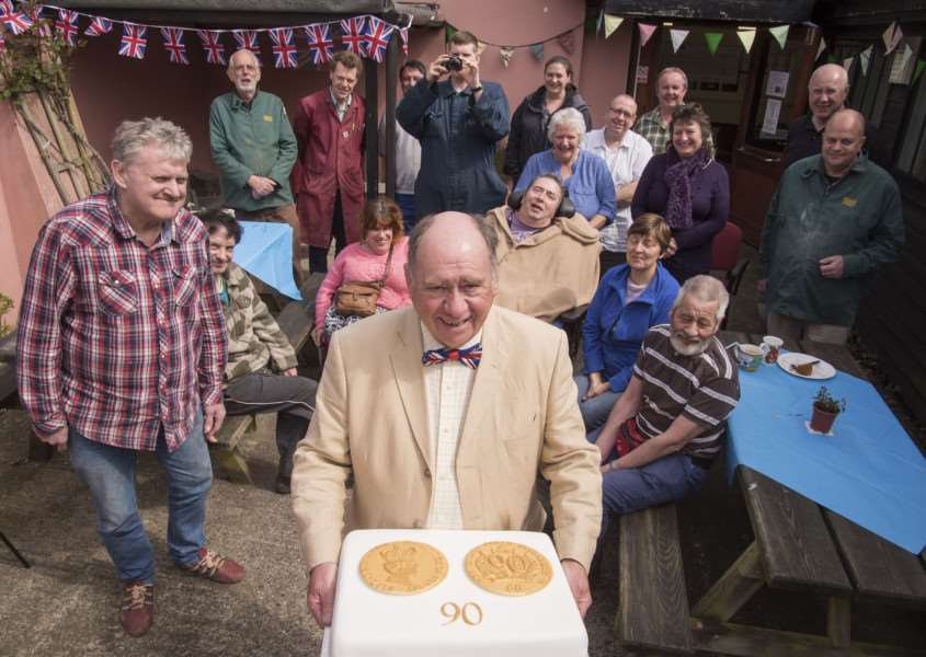 Street Forge workshop celebrates Queen's 90th. Pictured: Alan Stanley IT teacher holding the cake. Picture Mark Westley