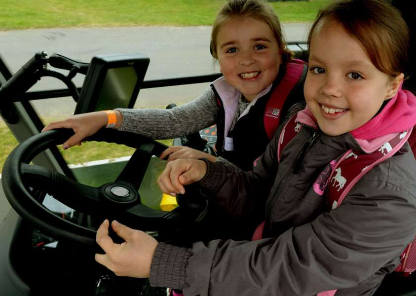 Wood Ley Primary School pupils Emily Peek and Darcy Rose at the controls of a tractor ANL-150427-212122009