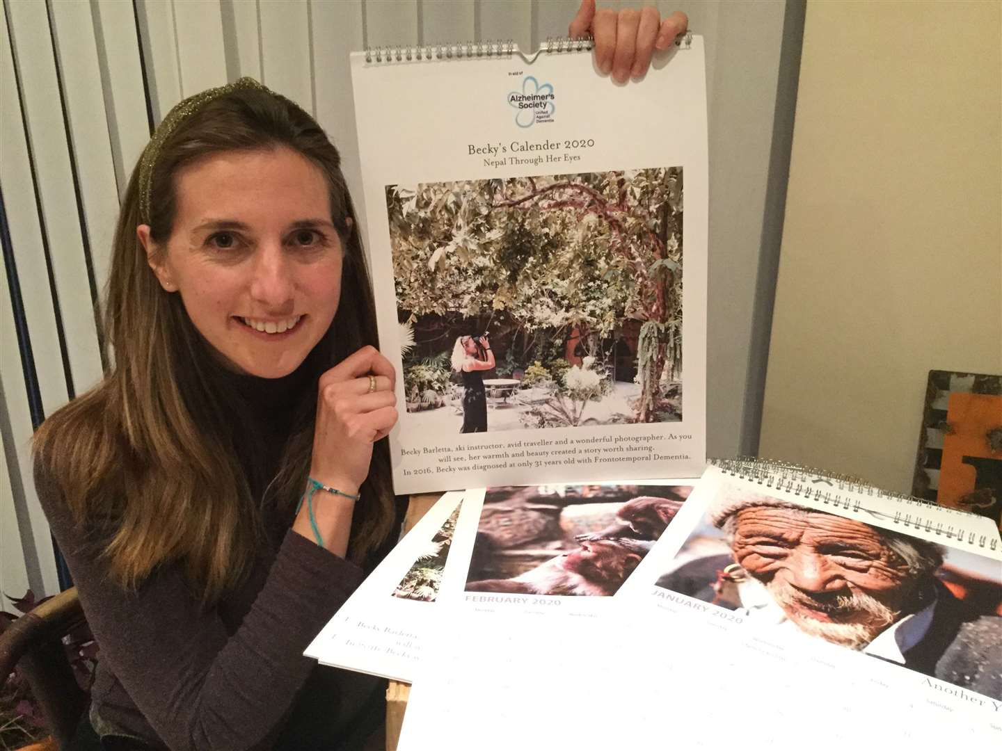 Kirsty Minton with the calendar she has produced to raise money for the Alzheimer's Society. Contributed picture