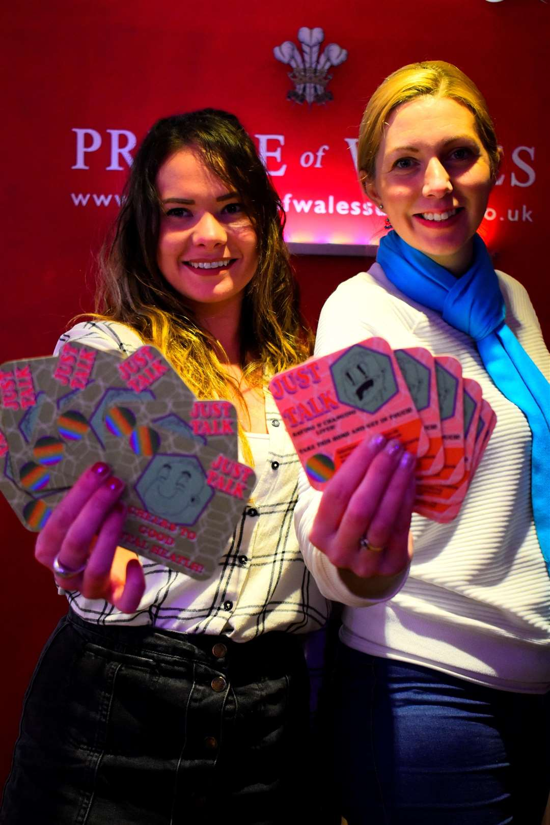 Lois Lovering and Natalie Wiggins with the Just Talk Campaign beer mats at the Prince of Wales pub. (1946846)
