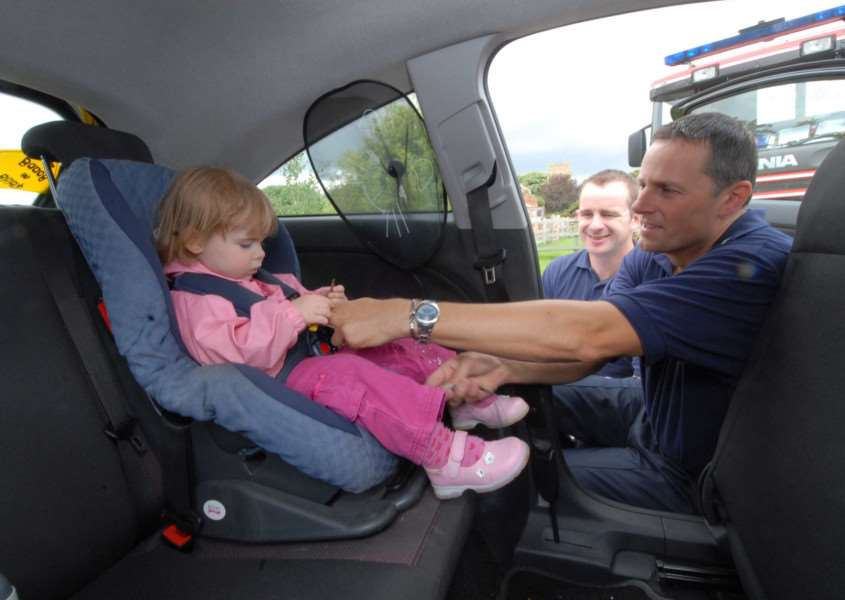 Stock image of Norfolk firefighters Kim Scotney and Mark Sands carrying out previous child seat fitting checks