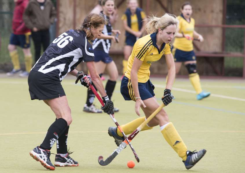 WINNING START: Hayley Stoneman (yellow) in action as Newmarket Ladies I got the new hockey season off and running with a 1-0 victory over their Bourne Deeping counterparts