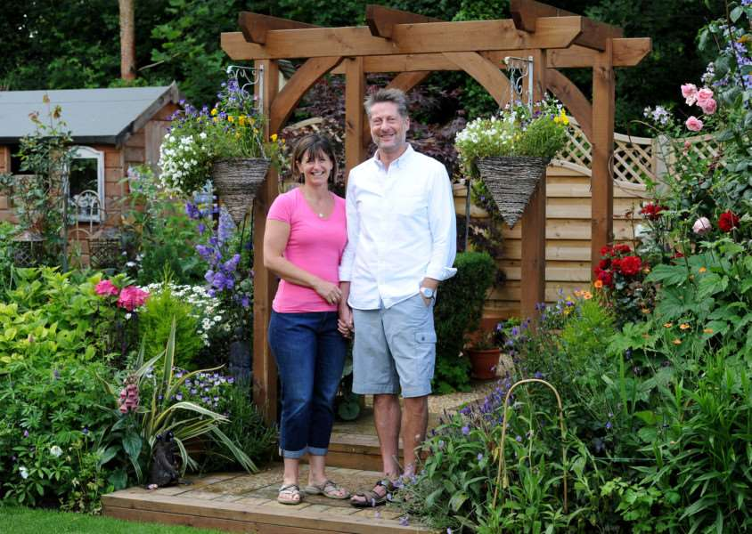 Charlotte and Mike Crichton in their garden