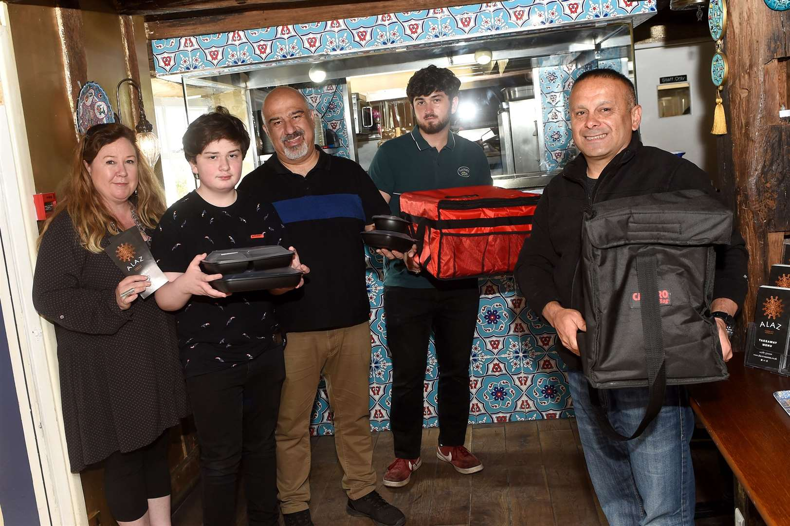 Alaz Turkish Cuisine in Sudbury has found success during the coronavirus lockdown by launching a takeaway service...Pictured: Susan Miller Tezel, Kaya Miller Tezel, Cengiz Tezel, Luka Uğurlu and Ali Yildiz....PICTURE: Mecha Morton .... (36343039)