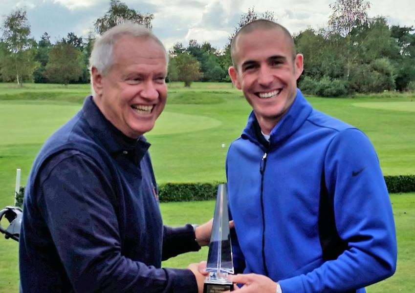 PROFESSIONAL TURN: Flempton GC Captain Andrew Long (left) presents coaching professional Lawrence Dodd with the Pro Challenge Trophy