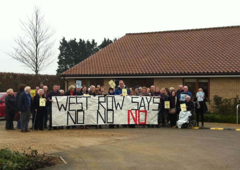 Members of the West Row Action Group outside the village hall ANL-150902-122335001