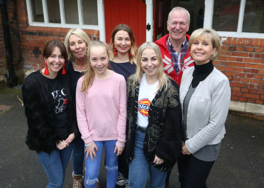 Gabriella Stanley (Centre R) pictured with her family at the Old School Hall in Long Melford. Gabriella organised a sale and is running two marathons to raise money for mental health charities.'Pic - Richard Marsham