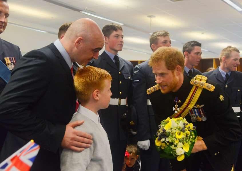 HRH Prince Henry of Wales was presented with an RAF Regiment Bear by Sam (10) with his dad FS Jordan Brown. Picture: Ian Burt