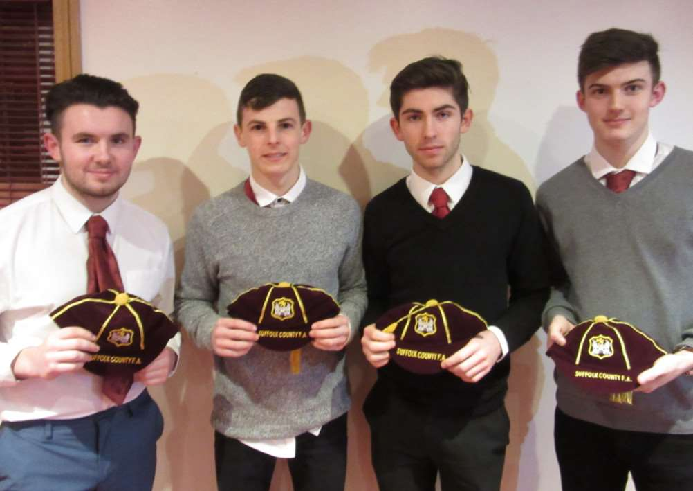 Haverhill Rovers players Rhys Shulver (far left) and Lawrence Healey (second right) collect their Suffolk FA county caps. With them are Ryan Jolland, from Bury Town and AFC Sudbury's Kyran Clements ANL-150216-123416002
