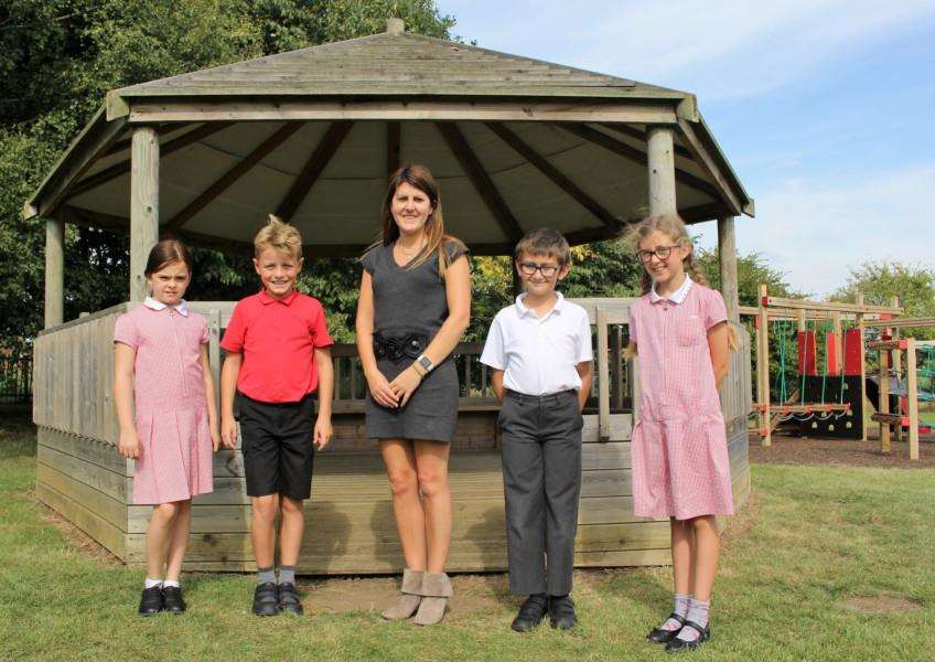 New headteacher at Wickhambrook Primary Academy Ros Towns pictured with pupils Ruby Loryman, 9, Jayden Perfect 9, Mitch Smith 10, and Maya Hattam 10.