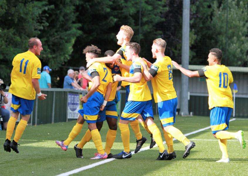 CHUFFED: Adam Mills celebrates his goal with his teammates