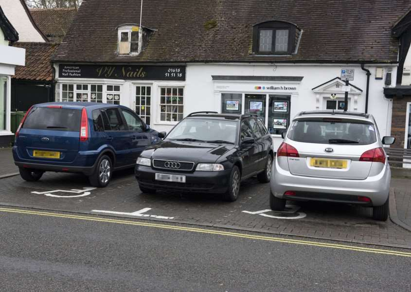 Up to three cars at a time are blocking disabled bays i n Mildenhall's Market Place ''Picture Mark Westley