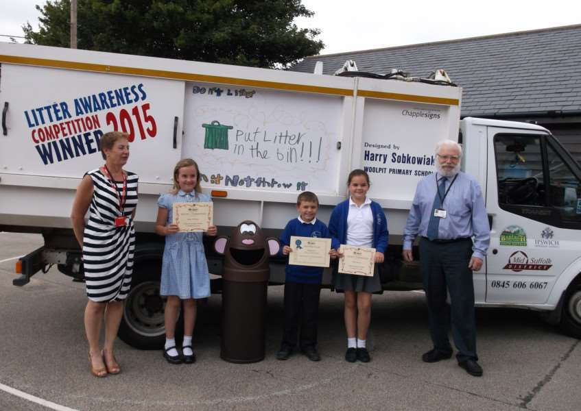 Henry Sobkowiak, nine, has won Mid Suffolk District Council's Litter Awareness poster competition. His wonning design has been slashed across the side of a council cleaning truck. ANL-150730-151129001
