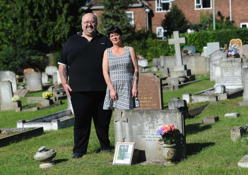 David Burroughs and his wife-to-be Paula Thomas at the grave of Ron's maternal grandparents