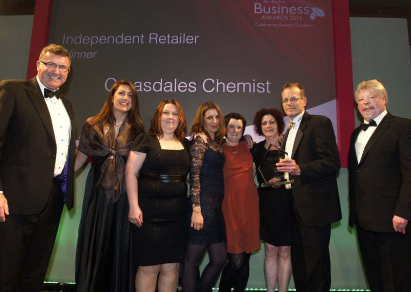 Bury Free Press Business Awards 2015 hosted by Simon Weston''Pictured: Independent Retailer Award presented by Nill Baker (Suffolk Show Director) - Croasdales Chemist ANL-151010-020237009