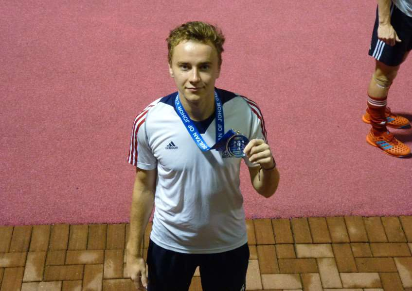 SILVER LINING: Alex with his silver medal from the Sultan of Johor Cup