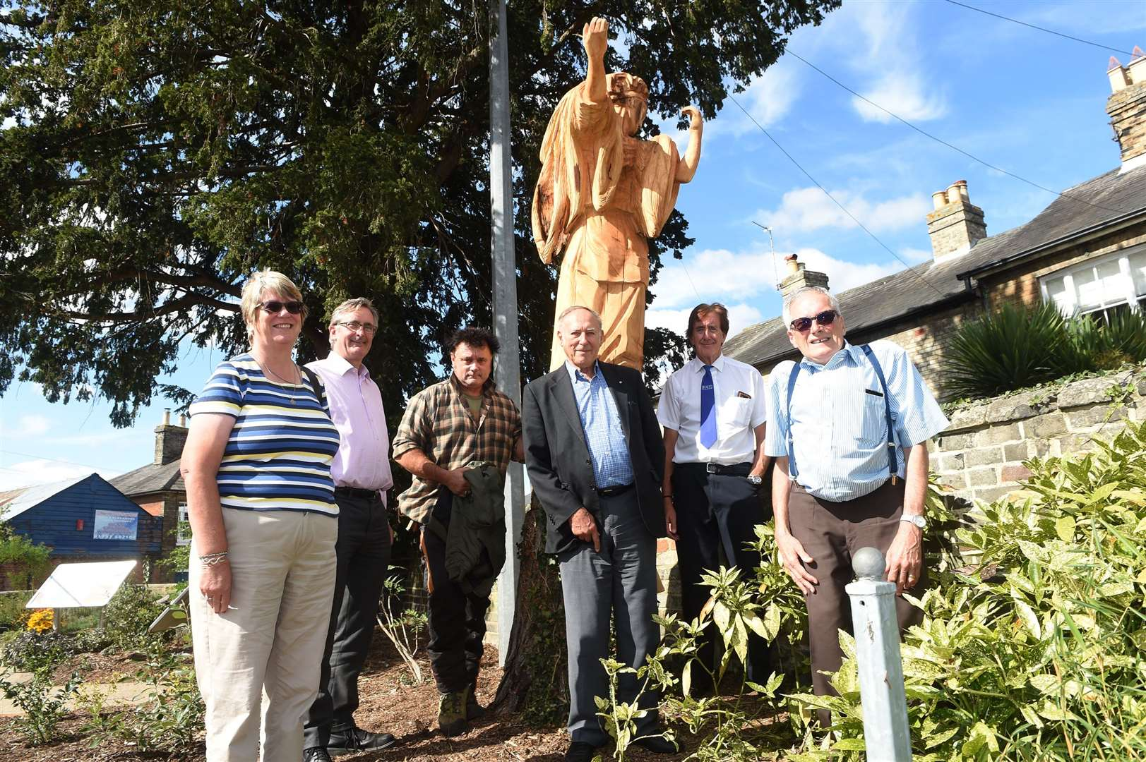 A project, which pays homage to Sudbury's silk weaving industry, is nearing completion..A statue in Weavers' Piece garden, carved out of a tree is a new edition to the site...Pictured: Marian Bailey, Chris Storey, John Moore (carpenter), John Sayers, Lyndon Collier and Andy Howes....PICTURE: Mecha Morton ... (16092491)