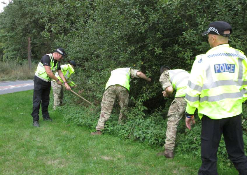Police, RAF and Military Police personnel search hedgerows beside the A134 between Bury and RAF Honington for Corrie McKeague ANL-160930-161432001