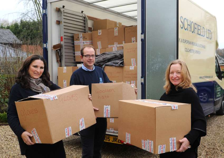 Lavenham residents have collected items to be delivered to refugees in Calais ''Pictured: Alison Shaw, Matthew Scofield from R&D Scofield Ltd (who are donating the lorry for free) and Louise Meyer Harrison ANL-150712-210005009