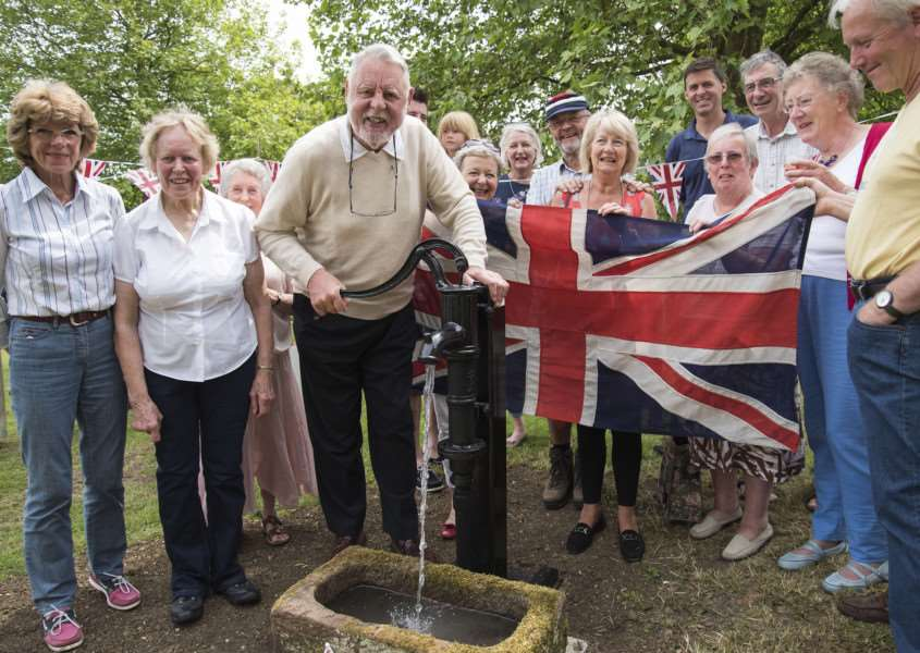 Jo Pask stands next to Terry Waite as he declares the pump 'open'