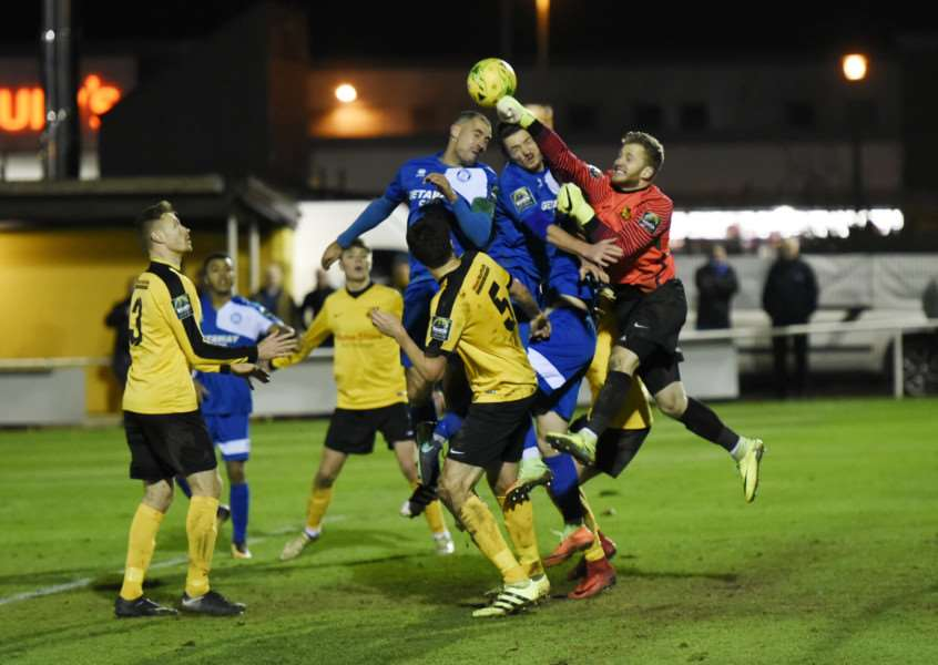 CLEAN SHEET: Recently-signed Mildenhall goalkeeper Jacob Marsden punches clear during Tuesday's stalemate. Picture: Mark Westley