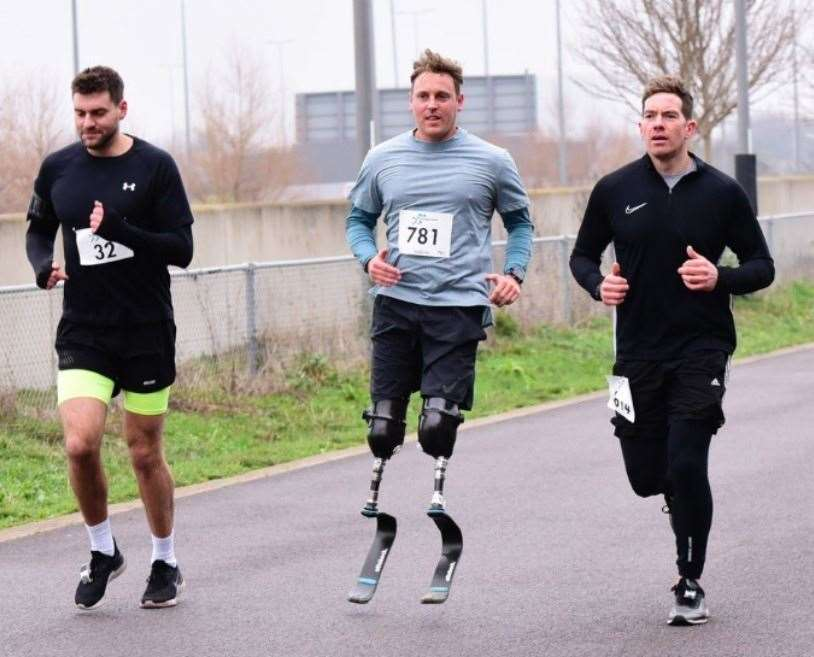 Shaun Whiter with training partners Martin Atkinson, left, and Ben Cooper taking part in the recent Stratford 10-mile race.