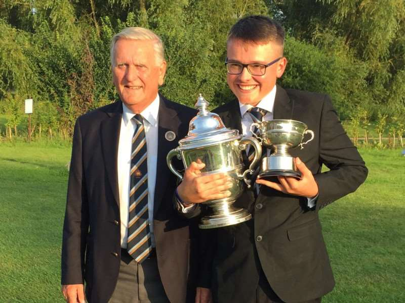 ALL SMILES: Suffolk Open Golf Champion Alfie Halil with Suffolk County Golf Union President Colin Firman Picture: Contributed