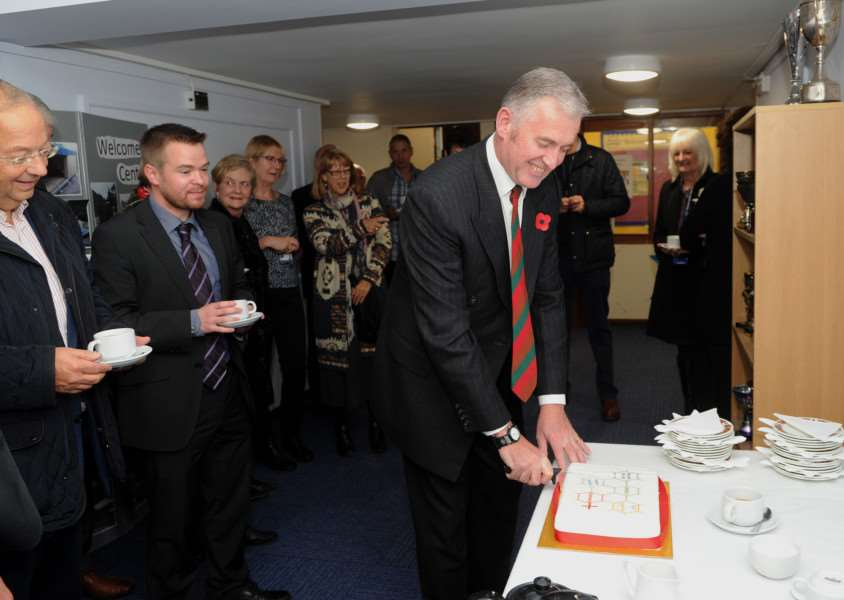 Chair of directors Neil Kellett cuts the celebration cake ANL-160411-175648009