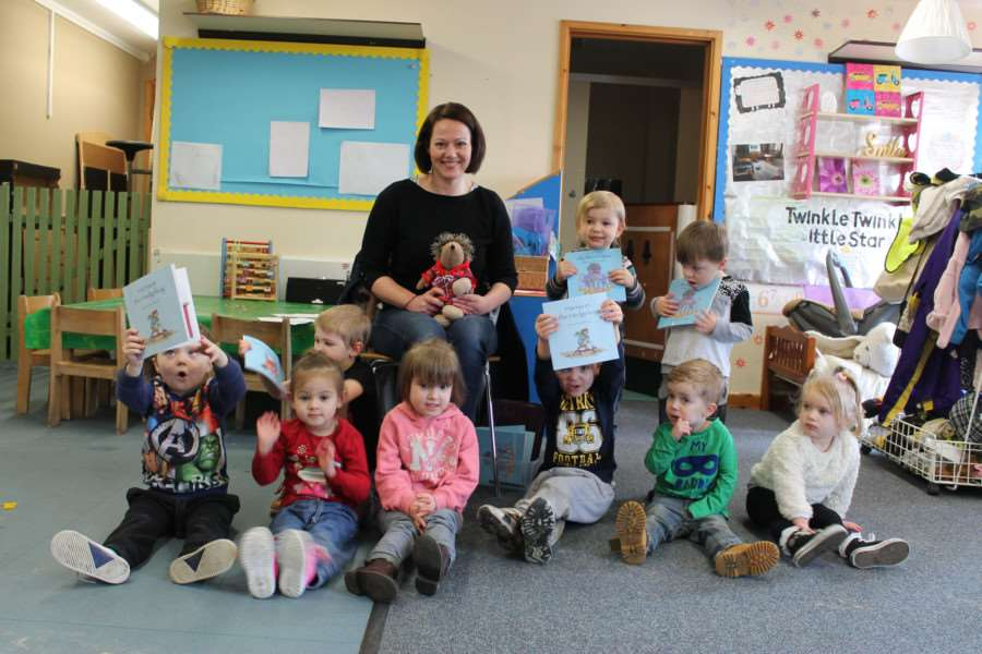 Author Victoria Brock spends some time with children at Puddlebrook Pre-School in Haverhill