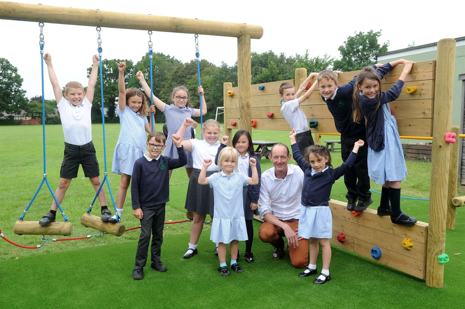 Ben Hemmings, headteacher of Chilton Primary School with pupils in the new play area. Picture by Mecha Morton.