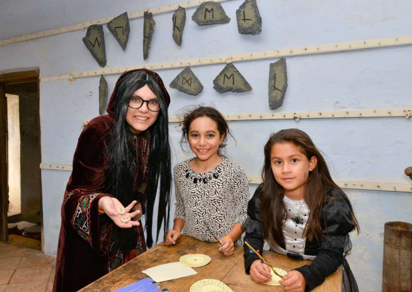 School of Sorcery and Magic at Kentwell Hall in Long Melord. Rune Master Grace Ludlam with Mona Hassan and Melissa Crispino (both 8)