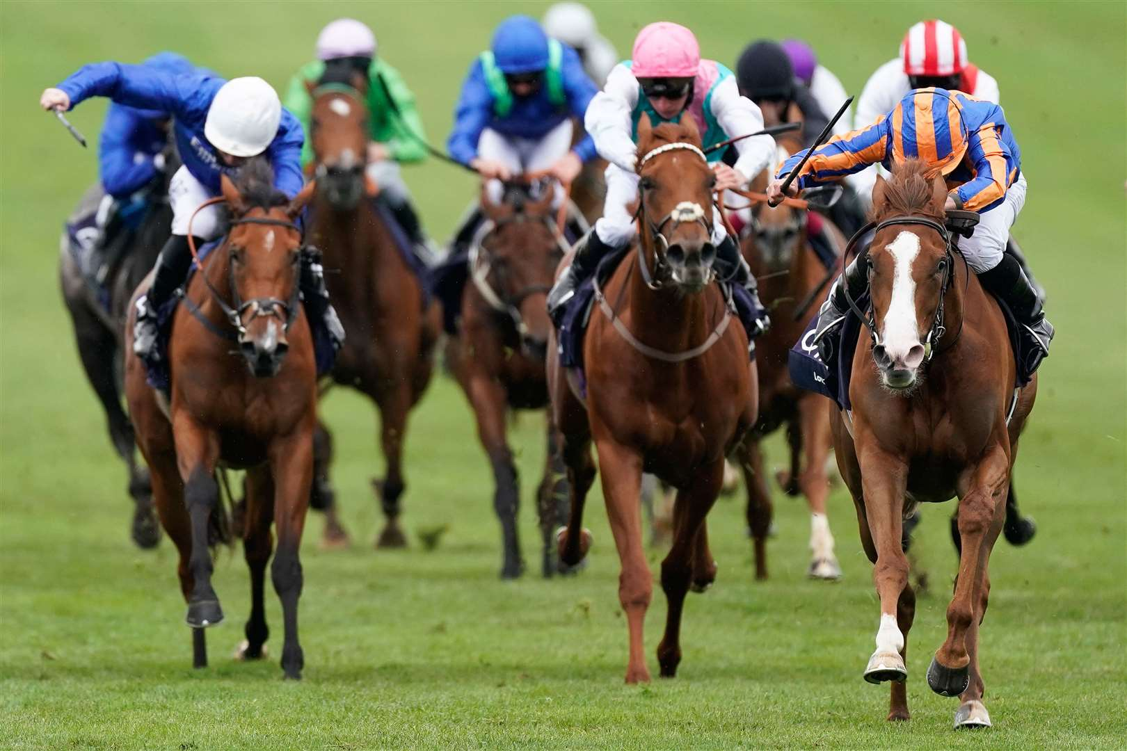NEWMARKET, ENGLAND - JUNE 07: Ryan Moore riding Love (R, blue/orange) win The Qipco 1000 Guineas Stakes at Newmarket Racecourse on June 07, 2020 in Newmarket, England. (Photo by Alan Crowhurst/Getty Images). (36301666)