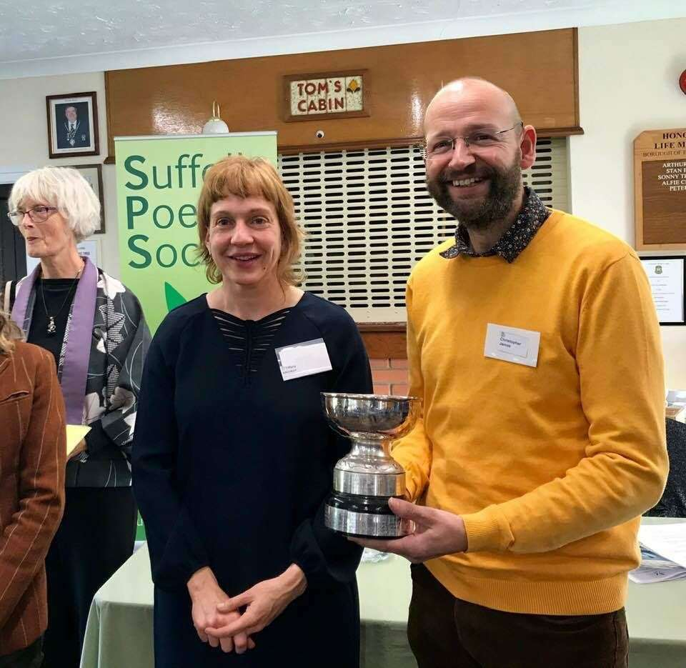 Chris James collects his Suffolk Poetry Society Crabbe Poetry Competition first prize from Dr Tiffany Atkinson. Contributed photo