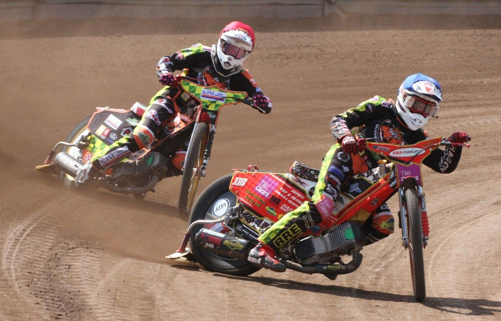 Drew Kemp (blue) in action for the Mildenhall Fen Tigers with Danny Ayres (red helmet)