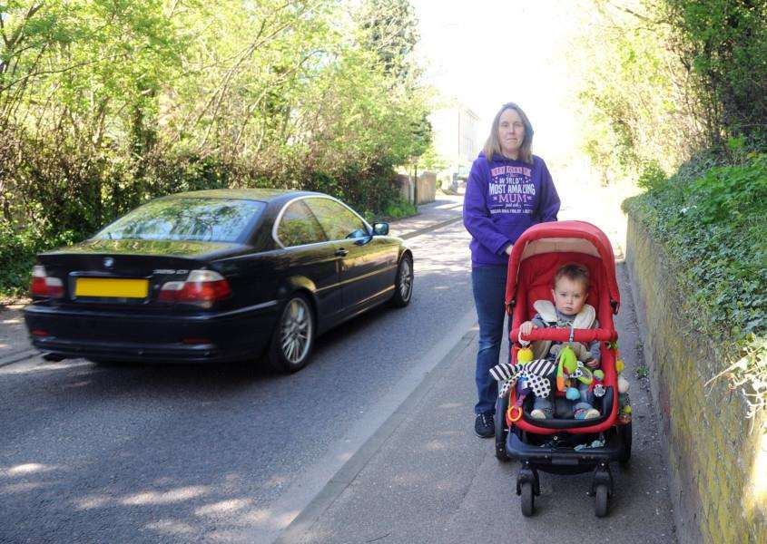 Laura McShane with son Austin at the narrow point in Burton End that she and other parents want made safer. '''Picture by Mecha Morton