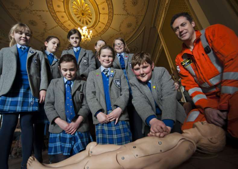 EAAA critical care Paramedic Neil Flowers teaching CPR to Form VI students at Moreton Hall Prep School