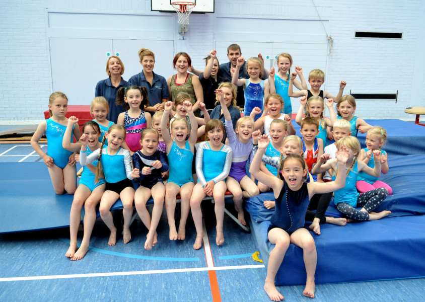Kids and head coach Kevin Woolcott (centre) at Haverhill Gymnastics Club are pleased about the town council giving them �25K towards their goal of building a brand new gymnastics centre. ENGANL00520130207162754