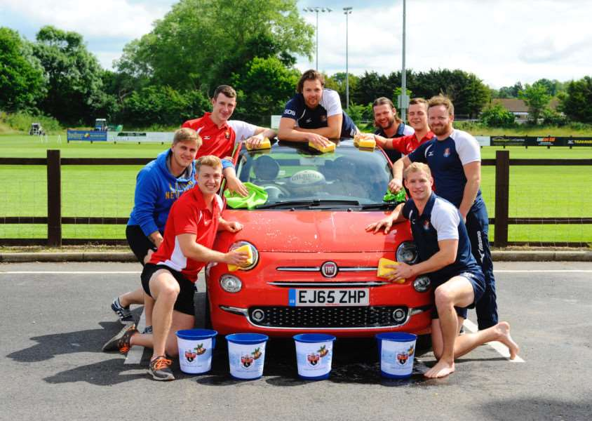 Sudbury, Suffolk. Members of Sudbury Rugby club taking part in a charity car wash as part of an ongoing fundraising effort to pay for a new community defibrillator.''Picture: MARK BULLIMORE