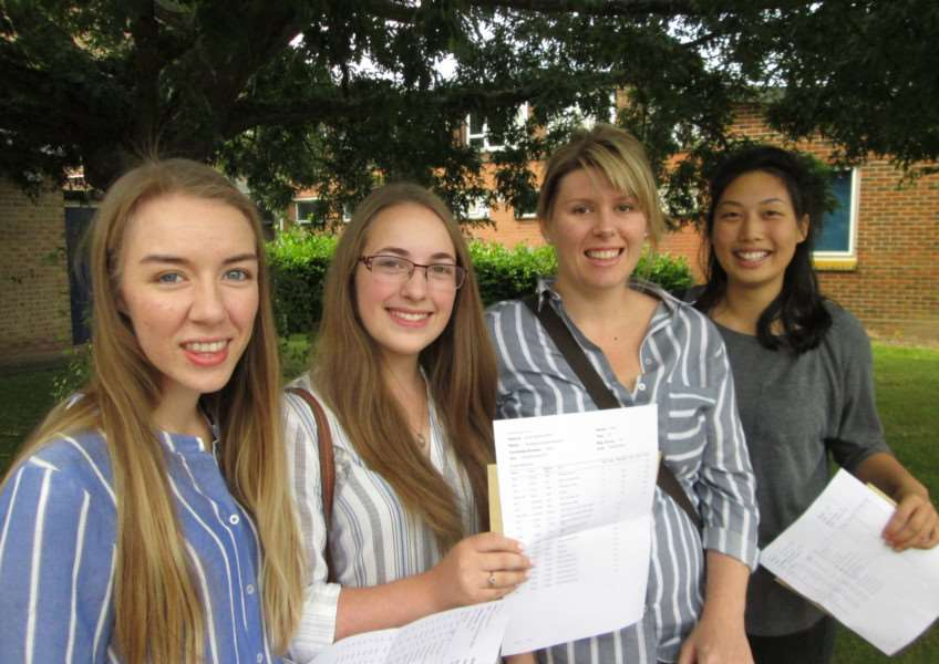 Ellie Parrington, Georgia Peacock and, right, Jasmin Le celebrate their results with their chemistry teacher Jenna Wetton at Mildenhall College Academy