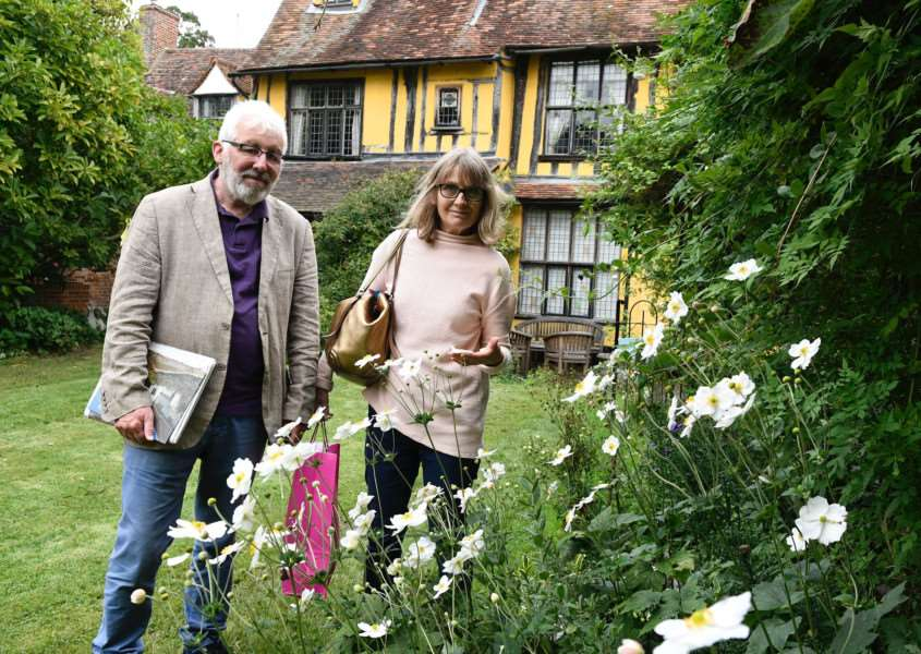 Lavenham, Suffolk. Lavenham Open Gardens event to raise money for St Nicholas Hospice. Pictured are Pete and Ali Cobb looking around a garden on Water Lane. ''Picture: MARK BULLIMORE