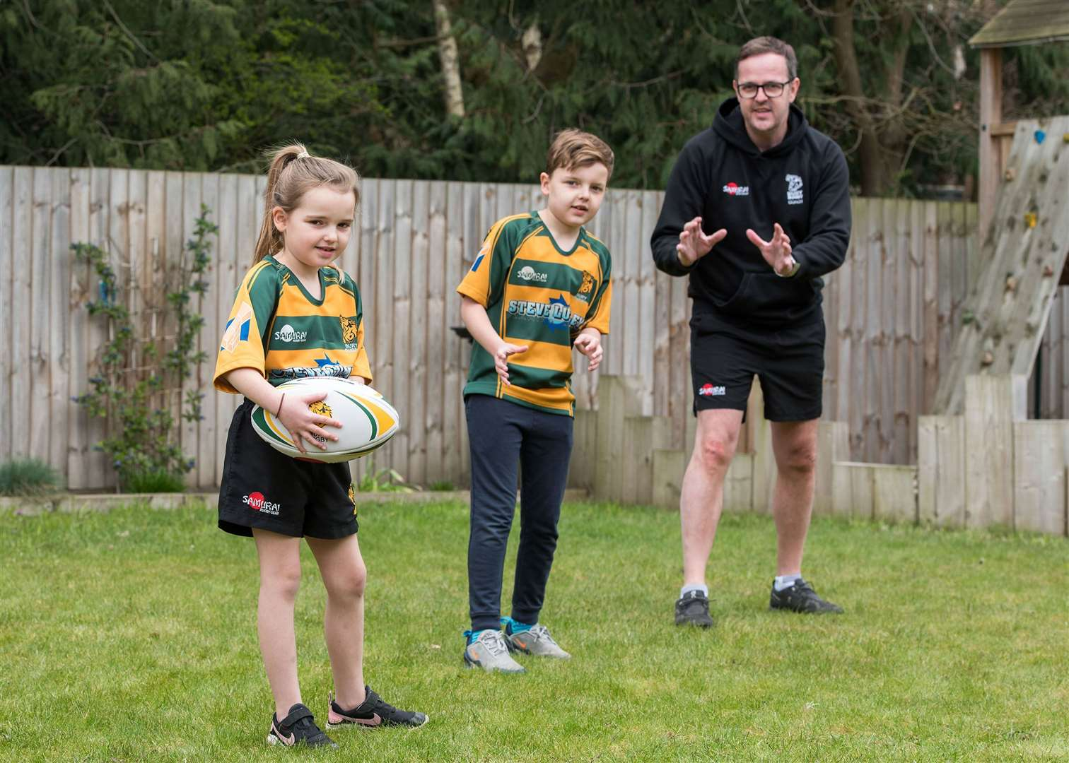 Bury rugby club minis' chairman starts a virtual pass..Bury St Edmunds Rugby Club Minis section have been keeping engaged during the lockdown through a virtual pass which is now over 1,000 views. .Minis chairman Craig Germeney started it off with his 2 children. Monty 10 and Delilah 7. Picture by Mark Westley. (32799348)