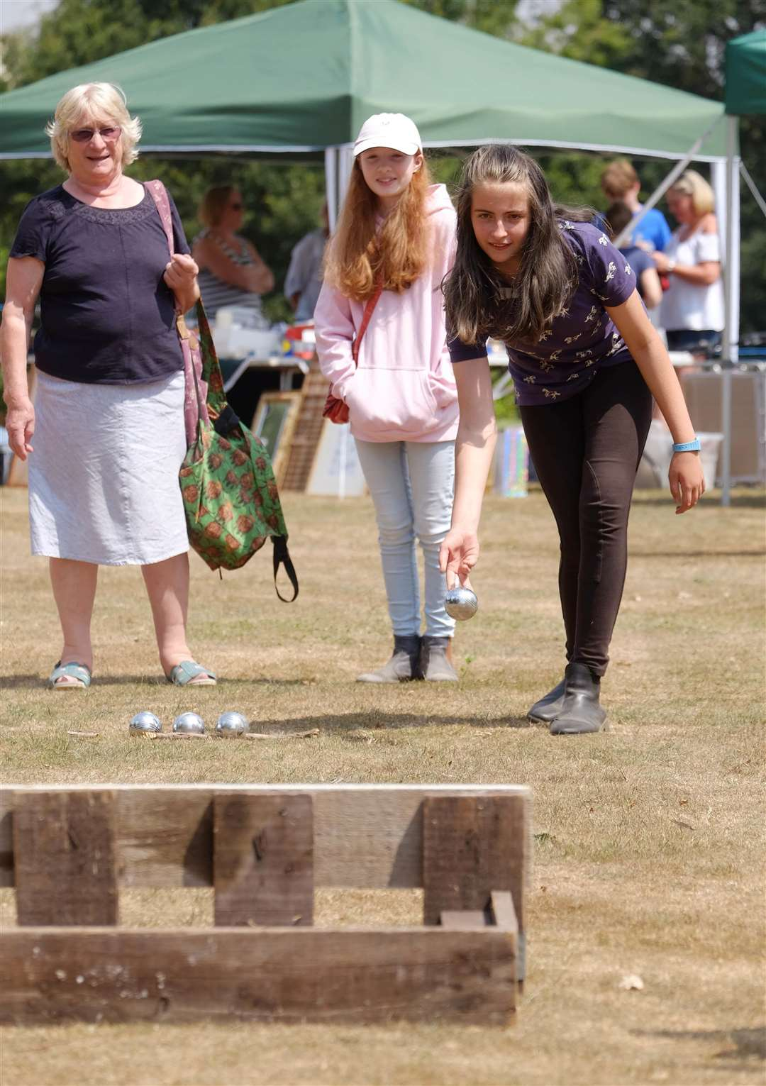 Shimpling Fete - Lucy fudge, 12 tries her hand at bowling.Pic - Richard Marsham. (3191680)