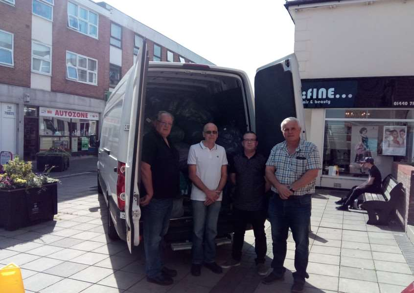 From left: David Roach, Pat Hanlon, Richard Moore and Tony Brown by one of the vans loaded up with donated items for the victims of the Grenfell Tower fire in west London.