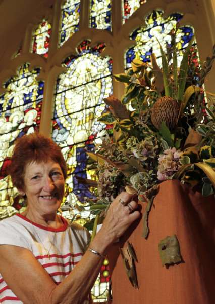 St Cuthbert's joins the Thetford Great Festival for the first time with All Things Bright and Beautiful flower festival. Pictured is Anne Benion with her floral display. ''Picture: MARK BULLIMORE ANL-160309-214930009
