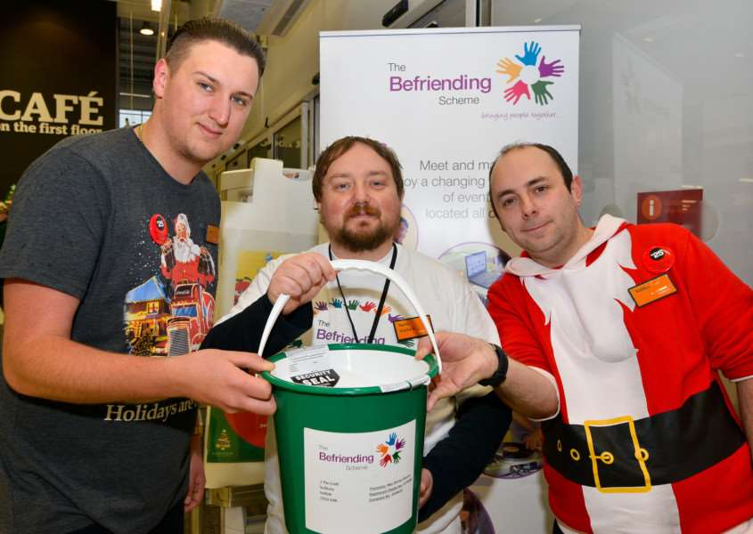 Rob Taylor (centre) from The Befriending Scheme raising noney for the charity in Sainsbury's Sudbury, with check out team leader Jake Brenchley and Duty Manager Robbie Voss. ANL-151214-122914001